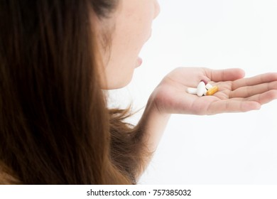 Drugs medicine , health care - close up of woman taking in pill