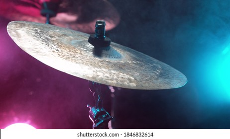 Drum cymbal detail with neon lights