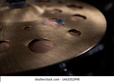drum cymbals with holes in dark