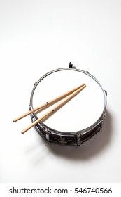 Drum and Drumsticks on white background