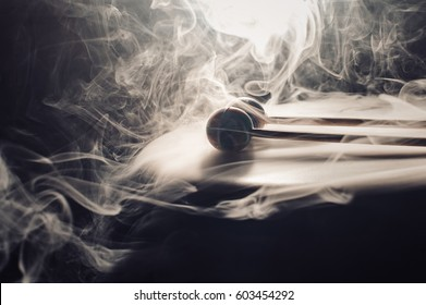 drum and drumsticks. Sticks with balls lie on the drum. in the smoke in light