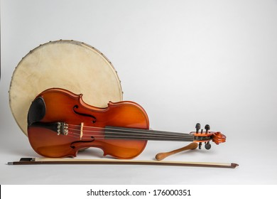 Drum and Fiddle. A Irish drum  (bodhran) and a viola on a white background