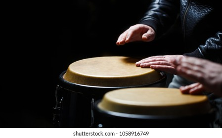 Drum. Hands of a musician playing on bongs. The musician plays the bongo. Close up of musician hand playing bongos drums. Afro-Cuba, rum, drummer, fingers, hand, hit.