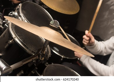 Drum plate, the drummer plays against the background