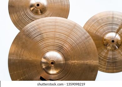 Drum plate, drum set on a white background, musical cymbals top view