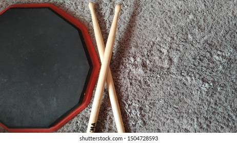 Drum practice with a drum pad and drum sticks