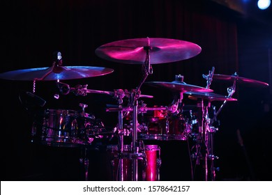 Drum set on rock concert stage.Professional musical instruments for drummer musician.Classic analog audio equipment for metal band live performance.Drumming instrument on rock festival