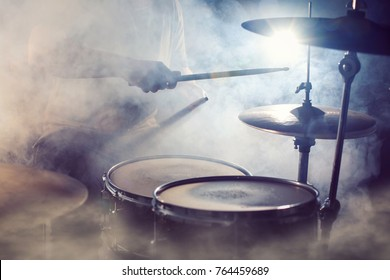 Drum set surrounded by fog