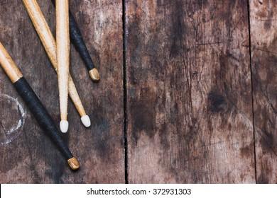 Drum sticks on the wooden background