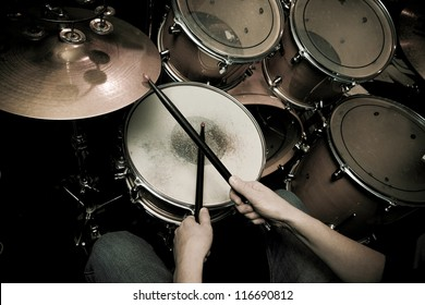 The drummer in action. A photo close up process play on a musical instrument