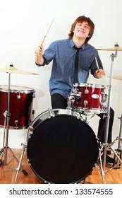 drummer man playing on drums studio shot