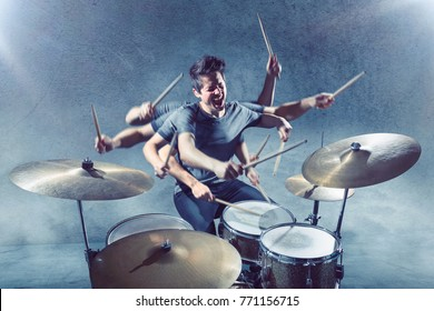 Drummer with multiple arms