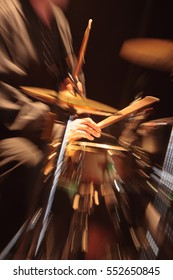 Drummer performing blurred in motion, intentional motion blur with lens, long exposure