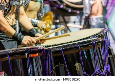 A Drummer is Performing on the Stage. A Musician is Drumming on the Drum Performance. Closeup View Of Man's Hands, Drums and Drumsticks.