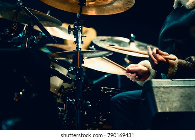 Drummer playing drums on a concert