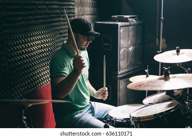Drummer playing drums at recording studio