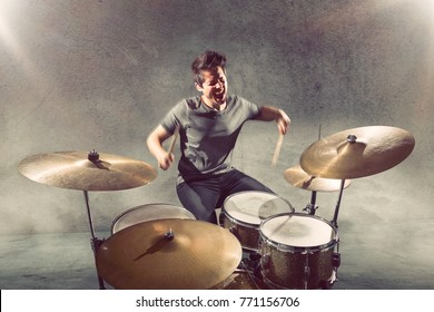 Drummer playing with mouth open
