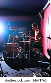 drummer playing on scene in club