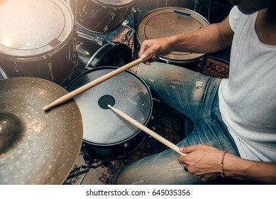 Drummer plays drum in studio