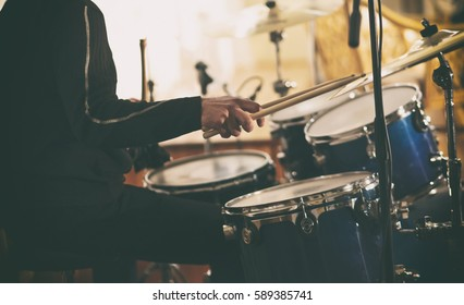 A drummer plays on drums