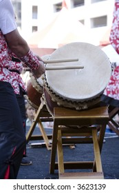 Drummers playing the Taiko Drums, a traditional Japanese instrument.