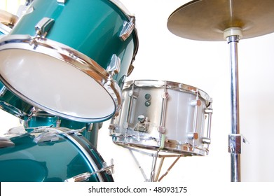 Drums and cymbals on isolated white background.