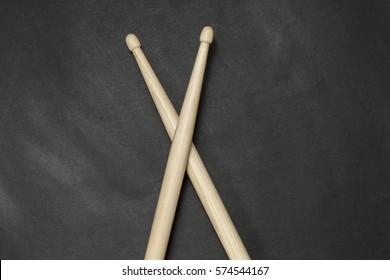 Drumsticks on a black background. Beautiful drumsticks