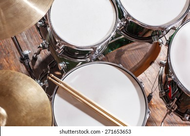 Drumsticks are on the drum set top view