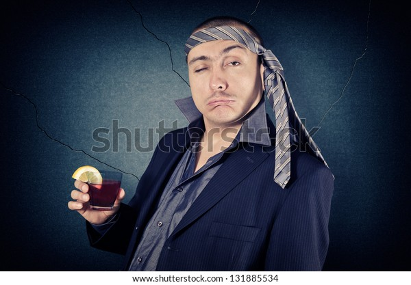 drunk businessman with tie on his head and a glass in her hand