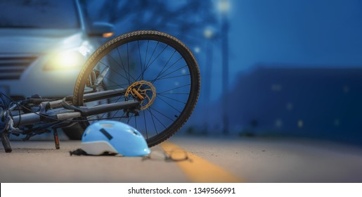 Drunk driving crashes , Accident car crash with bicycle on road at night time.
