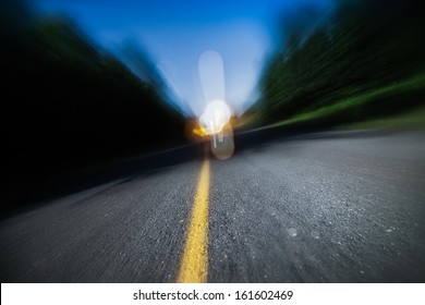 Drunk Driving, Speeding, Being too Tired to Drive are Potential Concepts for This Image of Blurry Road at Night