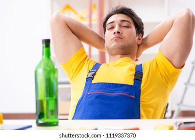 Drunk engineer working in the workshop