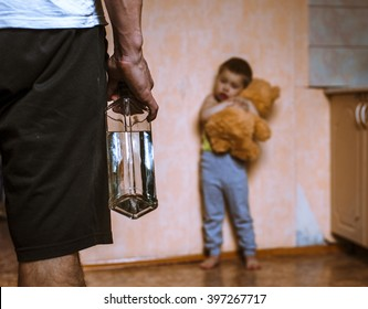 Drunk father and frightened child with toy bear. Domestic violence, abused child.