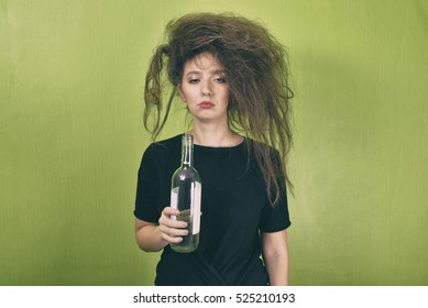 drunk girl with a bottle of wine on a yellow background