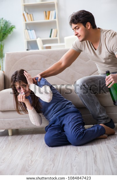 Drunk husband abusing wife in domestic violence concept