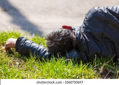 drunk man asleep on the grass