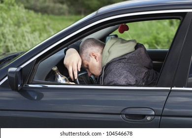Drunk man asleep at the wheel