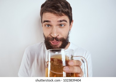 drunk man with beer on a light background