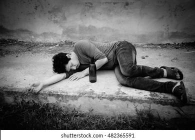 Drunk man with bottle sleeping, Homeless,Sad,Despair,Depressed,Black and white