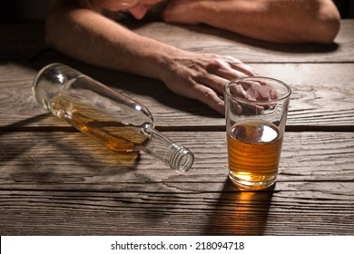 drunk man with a glass of brandy in the pub