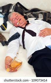 Drunk man lying in a messy bed
