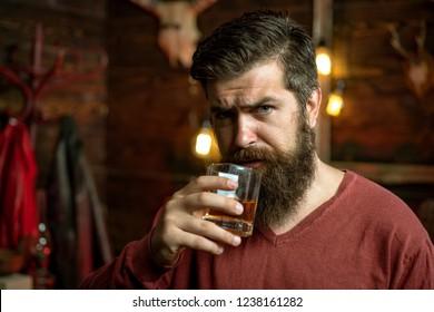 Drunk man. Whiskey, brandy, cognac concept. Drink barman. Pub retro vintage interior. Hipster barman concept. Alcohol addiction