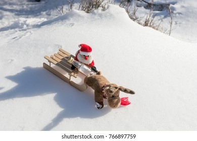Drunk Santa Claus with empty bottle on the sled