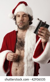 A drunk Santa Claus with flask and ripe with bad attitude.