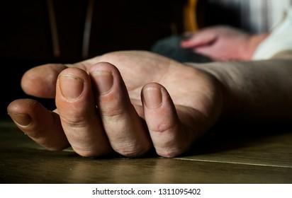 Drunk, sick or dead man lying on the floor