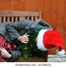 Drunk woman asleep on park bench after christmas party.