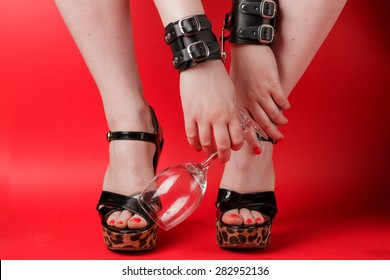 Drunk woman in leather handcuffs