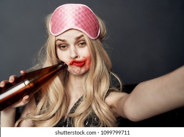 drunk woman with pink mask for sleepin