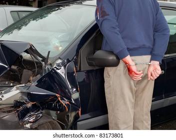 Drunken driver being arrested after car crash