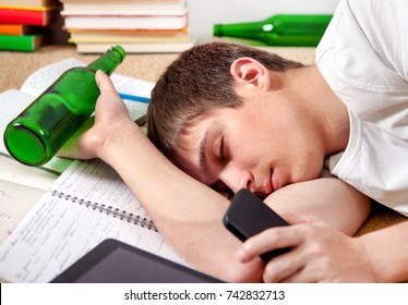 Drunken Young Man sleep on the Books with a Beer